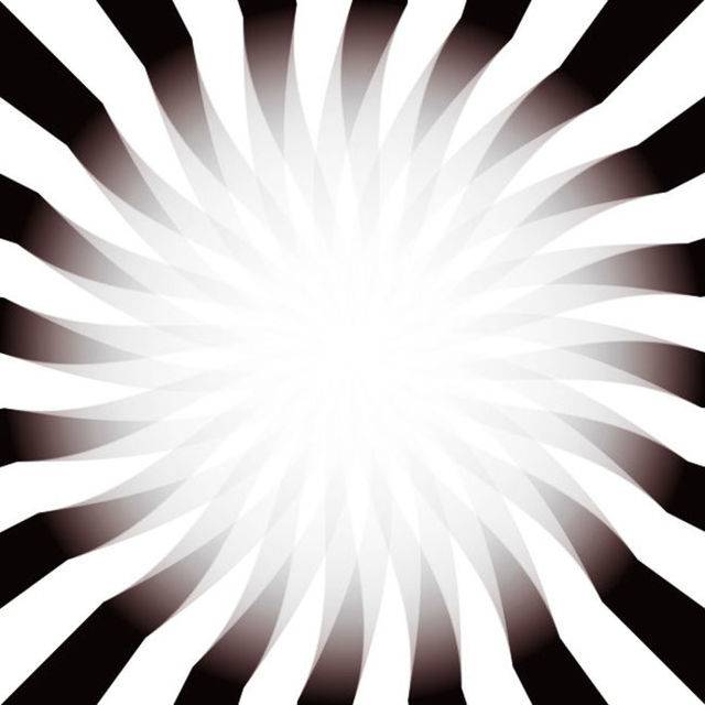Slowly move your head towards image and the light in the middle will get brighter. Move your head away and the light will become weaker.