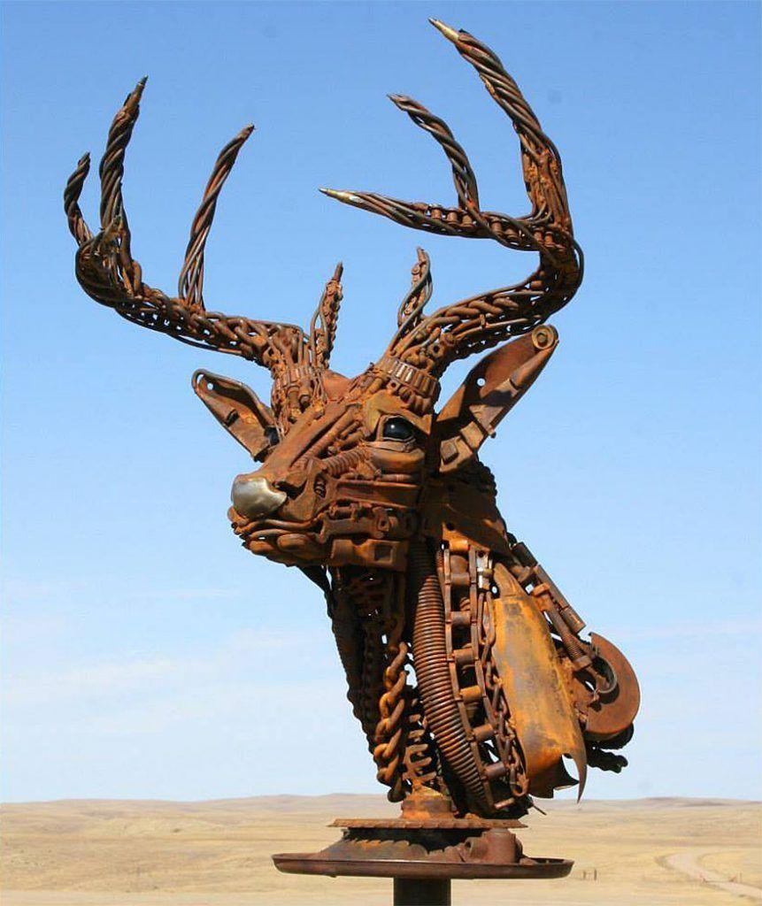 Un artiste transforme d'anciens équipements de ferme en de fabuleuses sculptures d'animaux.  Welded-scrap-metal-sculptures-john-lopez-1-861x1024
